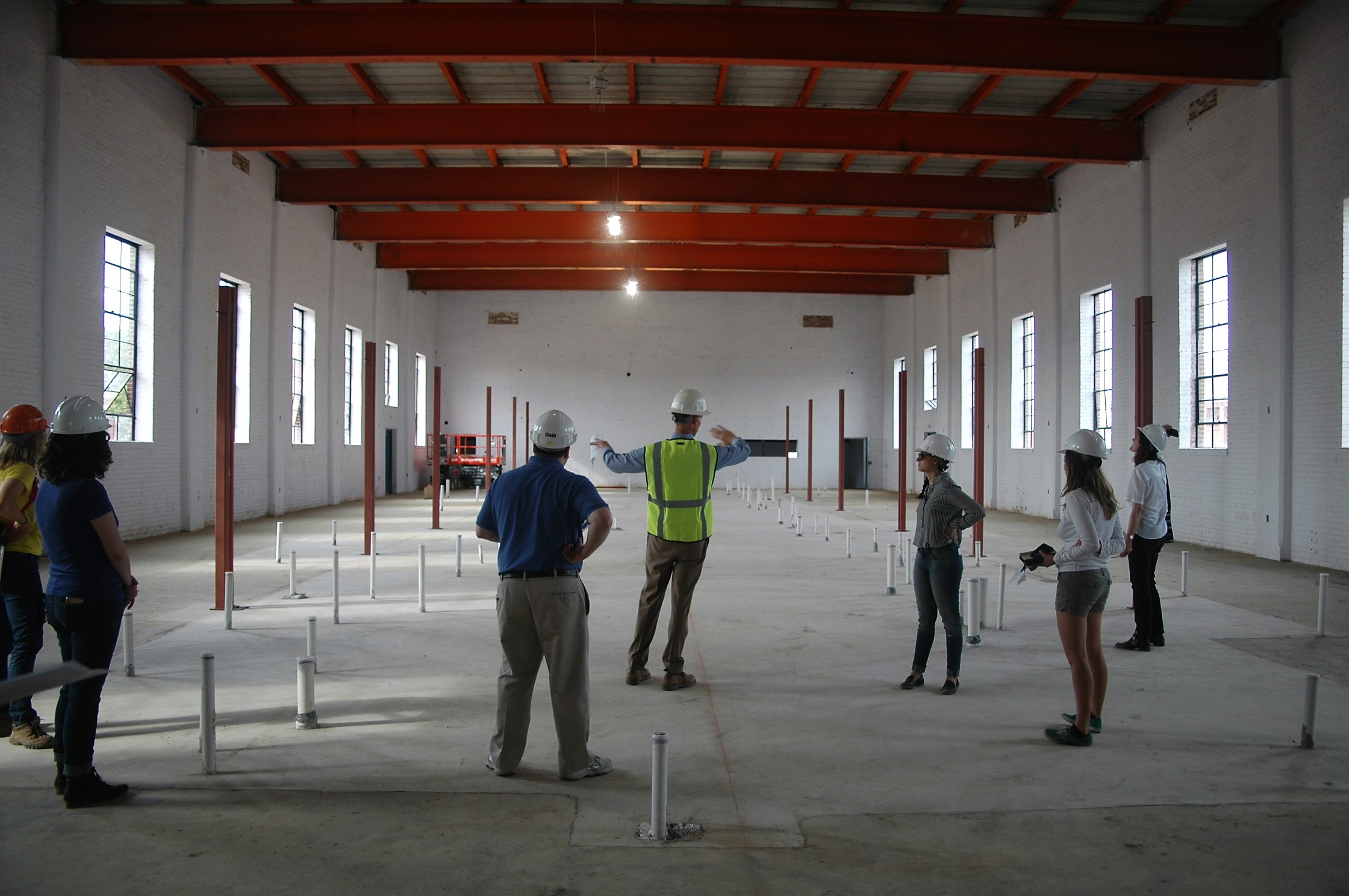 A room under construction at Liberty with sustainability features being described by an Elm Street Development employee.